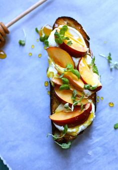 Nectarine Toast with Honey Goat Cheese captures all the wonderful fresh flavors of the season. This is basically a sweet bruschetta recipe with soft cheese, toasty bread, honey and fresh basil, and it's absolutely delicious.#comfortfood #vegetariandish #toastrecipe #studiodeliciouseats