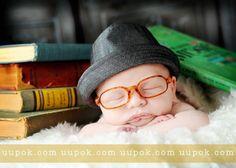Adorable newborn boy pose