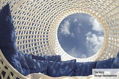SIGHT is a big white sphere made of woven plastic with an  upholstered interior. By gently lifting you get SIGHT into the desired position.