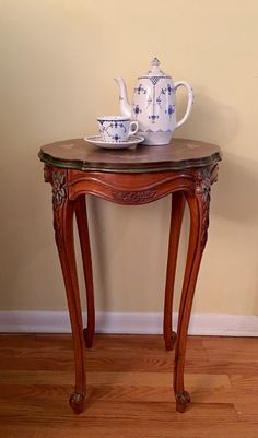 Antique Plant Stand with inlaid top and carved legs, $155