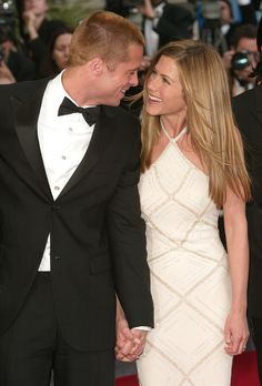 """2000 Golden couple Brad Pitt and Jennifer Aniston married in Malibu on July 29th, 2000. The now-divorced couple reportedly recited quirky vows, that included Brad pledging to """"split the difference on the thermostat"""" and Jennifer promising to always make his """"favorite banana milk shake."""""""