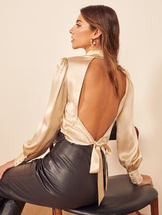 This is an open back top with a mock neck, puff shoulder sleeve, and tie back closure. The Cielo is slim fitting in the bodice. Mode Outfits, Fashion Outfits, Fashion Tips, Shiny Fabric, Who What Wear, Shoulder Sleeve, Chic, Backless, Stylish