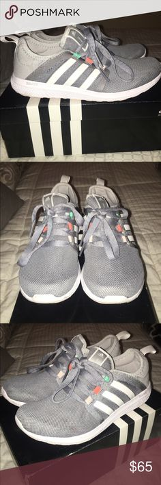 Adidas boost Adidas boost running sneaker. Gray with a hint of color. Beautiful sneaker bought brand new and worn twice. Perfect condition, bottoms are a little dirty due to wearing them outside, they can be washed. I can model upon request! Adidas Shoes Athletic Shoes
