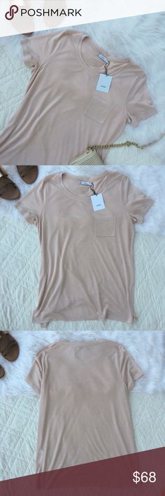 •Vince Light Beige Pink Pocket Tee Shirt• A perfect super soft crew neck tee shirt to add to ones closet. This tee includes a front pocket for a casual look.   •size: xs •color: light beige pink •incredibly soft •crew neck tee shirt •new with tags  •No trades(comments will politely be ignored). •15% off 2+ items  Vince Tops Tees - Short Sleeve