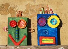 """instead of doing a 3D craft like this, we could modify it with a variety of random construction paper shapes/colors for the kids to """"build"""" (glue) a robot face/body creation onto a base paper."""