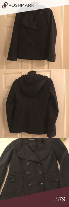 🍁SALE🍁Guess wool blend double breasted pea coat This coat has been worn, but is in excellent condition. It is a 50% wool blend. It is dark gray and has a hood. It has two front pockets that button closed. All buttons are intact. It has an inner button to keep extra warm. The buttons are black. Guess Jackets & Coats Pea Coats