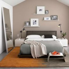 I like the idea of a rug beneath the mattress, the full-body mirror in the bedroom, the pictures on the shelves, and the floor lamps. The minimalism is refreshing, too
