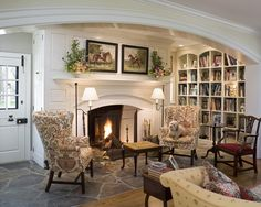love this ~ fireplace, bookshelves, flagstone floor & horse pictures above the mantel ~ from Canary Cottage