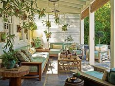 """Steven Gambrel designed his outdoor sitting area to feel like a living room, complete with custom sofas and tables. The staghorn ferns lining the walls connect the ""room"" to the garden. Blinds can be adjusted if the sun setting over Sag Harbor Cove becomes too intense."" photo: Eric Piasecki"