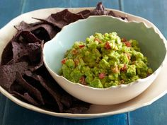 Celebrate Cinco de Mayo with Rachael's 10-Minute Guacamole, made with just a handful of classic ingredients.  #RecipeOfTheDay