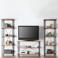 The Myra Vintage Industrial Modern Rustic Bookcase has a weathered and timeworn patina allowing traces of natural wood and original colors to show through. The frame is made of black sand metal with ample shelf storage.