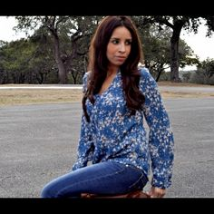 Lauren Conrad Blouse This beautiful blue, pink, and white blouse has gold button details down the front and on the sleeves. It is semi sheer and is meant for a flowy fit. I have never worn this shirt other than to try it on. Lauren Conrad Tops Blouses