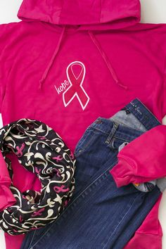 """Get comfortable, get cozy, and get committed to a cause. Embroidered with a the word """"Hope"""" next to a large pink ribbon, this oversized hooded sweatshirt is a super-cozy way to warm up while sharing your commitment to the cause."""