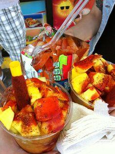 mangonadas and tostilocos. (mango ice cream, chunks of mango, chili powder, chili sauce, and a tamarindo stick)
