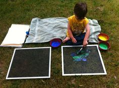 Place paper under a window screen and paint on the screen to create fun outdoor art projects for your children's outdoor play area or preschool playground. #playoutdoors #artproject
