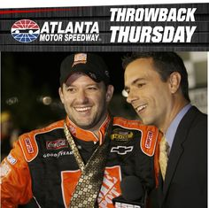 Tony Stewart takes hope AMS President and GM Ed Clark's tie after a 2006 win at Atlanta