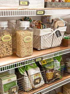 See-through containers are good options for kitchen pantries: They help all family members easily find what they need and help you know when you need more supplies. Here, mid-size wire baskets hold similarly packaged food items -- crackers or bags of chips, for example -- while clear pitchers offer self-serve storage for cereals. Always make sure your containers are food-safe, especially when repurposing old items.
