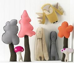 I love the idea of trees and mushrooms and all kinds of little woodland friends to make a play set.
