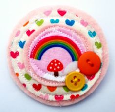 Oh so colourful, with hearts and buttons and a rainbow and mushroom too x