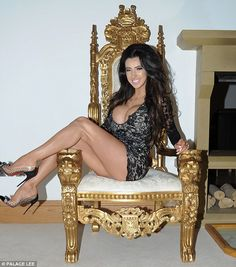 Queen Chloe:Chloe beamed with pride and satisfaction as she posed on a lavish gold throne