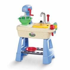 The is the funnest thing.  A mud pie making kitchen.  They have all kinds of mud pie making accessories too.  I would have loved this as a kid. I love it!