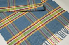 Plaids and Stripes (cotton)  Rhyme and Reason and McLeod's Praise© are simple tartan plaids that adapt wonderfully to rag rugs.  R&R4 Sky Blue, Lime,  Fuchsia, Marigold, Natural  From The Weavery