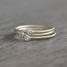 Gold Moissanite Ring. Love stackable rings.