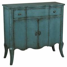 "Two-door cabinet with one drawer and a weathered teal finish.   Product: CabinetConstruction Material: WoodColor: TealDimensions: 34"" H x 36"" W x 14"" D"