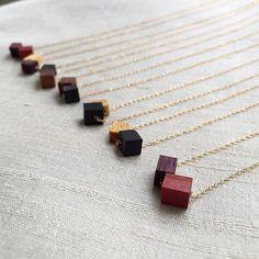 * 【wood cube ネックレス】. . オーダー分も含め、 新しいwoodパーツ増えました♪ 着色を一切していない自然の木を 楽しんでいただければと思います。  素材は全て14kgf。  #onzyu #woodaccessories  #jewelry #14kgf #accessories