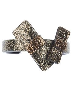Black plastic cuff from Marc Jacobs featuring a gold glitter effect , double bow front and silver tone logo engraved disc.