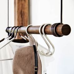 The Swing coat rail by the manufacturer LindDNA: Coat rack made of Danish oak and recycled leather, available in the Connox interior design shop. Hair Salon Interior, Salon Interior Design, Coat Rail, Recycled Leather, Wishbone Chair, Clothes Hanger, Clothes Storage, Room Inspiration, Dna