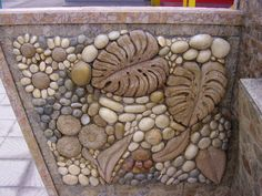 A beautiful combination that could be used for decoration in a garden. Stone mosaic Love the sunflower/daisies