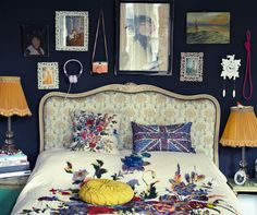 OH MY GOSH. I am in love with the wall color, wall art, lampshades, and duvet. Beautiful.