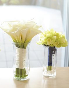 """I'm going to put vases of water on the head table evenly spread out along the entire table. Instead of buying flowers to put in those """"centerpieces"""", water will already be in th vases when we enter the ballroom and my bridesmaids and I will put our bouquest in the vases. It will save money on centerpieces and my bridesmaids' bouquets will live through the night."""