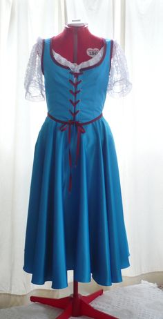Belle's peasant dress on OUAT.  I could probably make this fairly easily.  ( And, maybe my date could go as Rumple ;) <3 ) Character Inspired Outfits, Disney Inspired Outfits, White Peasant Blouse, Village Girl, Blue Corset, Belle Costume, Belle Dress, Cool Costumes, Cosplay Costumes