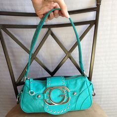 Guess Shoulder/Hand Bag Guess bag, turquoise, teal, silver hardware, zipper and magnetic closure.  Used a few times, still in excellent condition! Guess Bags Shoulder Bags