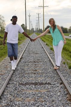 train track, railway, railroad couples and engagement picture. Reveal Photography, Chilliwack & Kelowna, Wedding + Family Photographer, Fraser Valley & Okanagan Valley. www.revealphotograph.com