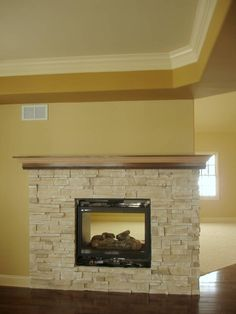 Love the double sided fireplace idea