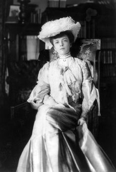 """Alice Roosevelt, Theodore Roosevelt's eldest daughter, who not only cut her wedding cake with a sword, defied all the conventions of her day regarding women, and who also had a pillow embroidered with her most famous quote on her couch; """"If you haven't got anything good to say about anybody, come sit next to me."""" 1902"""