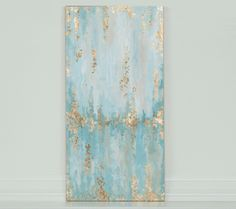 "12"" x 24"" gold leaf abstract painting with light teals and blue"