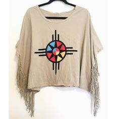 Urban Outfitters Fringe shirt  Totally adorable shirt / poncho to complete your fall wardrobe! Color is taupe  shirt has been gently worn is in great condition except for a small bleach stain on the sleeve (very unnoticeable& blends in with the shirt) which is not visible when the shirt is actually worn! One Size Fits Most! trades/ PP ✔️bundle discount  use the blue button to make an offer Urban Outfitters Tops Tees - Short Sleeve