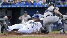 Kansas City Royals' Mike Moustakas (8) scores past New York Yankees catcher Brian McCann (34) on a double by Lorenzo Cain in the first inning during Friday's baseball game on May 15, 2015 at Kauffman Stadium in Kansas City, Mo.
