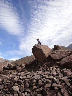 A little local scales a boulder near the small village of Armed in Marrakech, Morocco's Atlas Mountains.