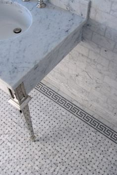 Carrera Marble with inlays and Greek key.