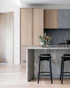 Beautiful kitchen in grey, light oak, and white.