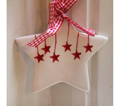 White & Red Ceramic Star Christmas Decoration - Espression Arts has these in stock - great decorative idea x x