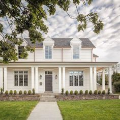 Charming traditional house construction by The Fox Group. Grey door with white siding. #thefoxgroup #houseconstruction #englishcountry #architecture English Farmhouse, White Farmhouse, Farmhouse Homes, Modern Farmhouse, Farmhouse Plans, Traditional Brick Home, Traditional Exterior, Black Window Frames, Black Windows