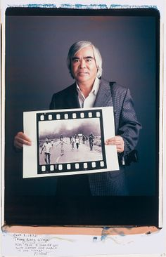 Master of reportage photography Nick Ut  holding photo of the Vietnam War in 1972.