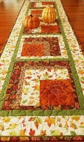 This quilted autumn table runner is extra wide and long - perfect for your fall or Thanksgiving table. Beautiful russet sunflowers are featured in each block and surrounded by fall leaves, berries, and acorns, along with a multi-colored cobblestone print Patchwork Table Runner, Table Runner And Placemats, Fall Table Runner, Quilted Table Runner Patterns, Quilted Table Runners Christmas, Christmas Placemats, Fall Sewing, Place Mats Quilted, Autumn Table