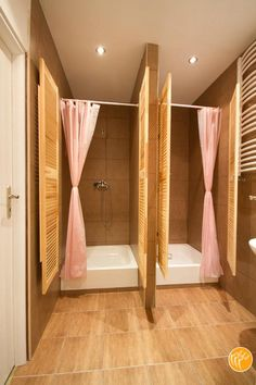 bathroom with more than one shower there. Would put bigger built in lights above…